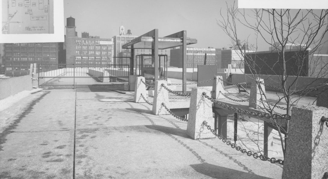 Historical photo of pedestrian bridge over UIC Circle Campus with brick factories visible in the distance.