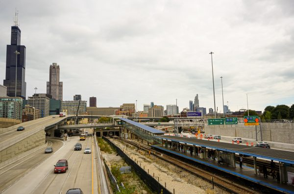 Chicago skyline with CTA train and highway in the foreground